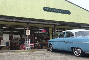 Antiques of Winfield storefront with classic car parked in front