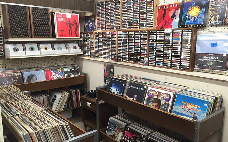 Booth of classic music memorabilia, vinyl records, cassettes