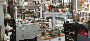 Picture of antique booth filled with furniture and old collectibles
