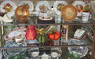 Dishes and collectibles featured in booth 19 at Antiques of Winfield